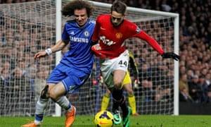 David Luiz, left, challenges Manchester United's Adnan Januzaj, who caused Chelsea problems