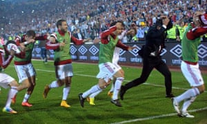 Albania's players run for cover  during