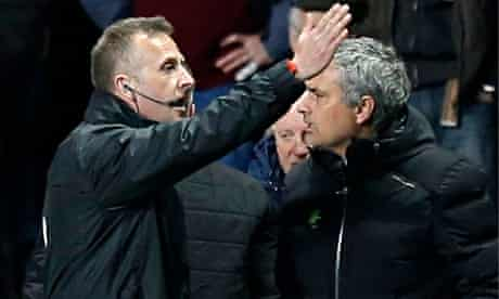 Chelsea's José Mourinho is shown out of the dugout by fourth official Jonathan Moss at Aston Villa
