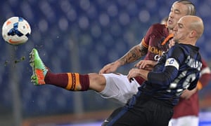 Inter's Esteban Cambiasso battles for the ball with Roma's Radja Nainggolan during the Serie A match