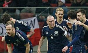 Scotland's players celebrate Scott Brown's winner against Poland in Warsaw