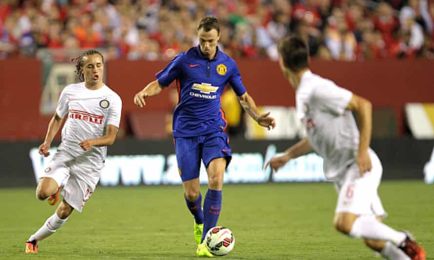 Manchester United's Jonny Evans, centre, has been part of Louis van Gaal's three centre-back system