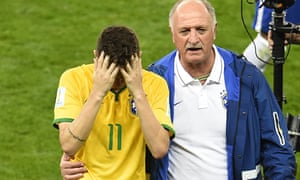 Brazil's coach Luiz Felipe Scolari helps Oscar off the field after losing the semi-final in Belo Hor