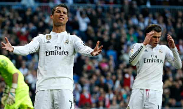Real Madrid's Cristiano Ronaldo, left, shows his frustration after Gareth Bale did not pass to him