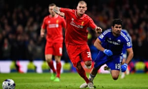 Chelsea's Diego Costa is brought down by Liverpool's Martin Skrtel in the Capital One Cup semi-final