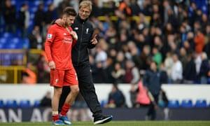 Liverpool's manager, Jürgen Klopp, with Adam Lallana at full time at Tottenham