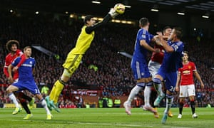 Chelsea's Thibaut Courtois punches the ball clear against Manchester United in 2014