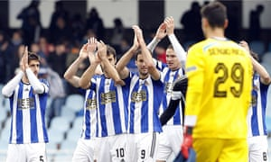 The Real Sociedad players celebrate their 4-3 victory over Sevilla in La Liga