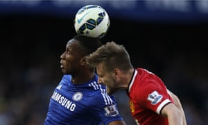 Manchester United's Luke Shaw, right, goes up for a header with Didier Drogba of Chelsea