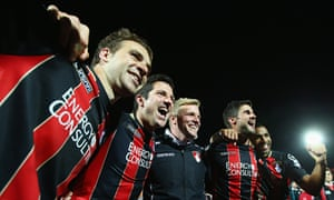 Eddie Howe, third from left, celebrates with his Bournemouth players after the win over Bolton