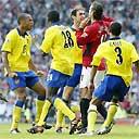 Ruud van Nistelrooy feels the full fury of Arsenal