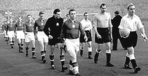 Billy Wright and Ferenc Puskas lead England and Hungary out at Wembley in 1953