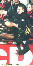 Eric Cantona attacks a fan