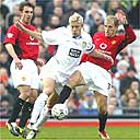 Alan Smith tussles with the ugly sisters
