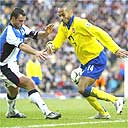 Thierry Henry and Lucas Neill