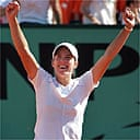 Justine Henin-Hardenne celebrates after winning the French Open