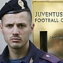 A policeman stands in front of Juventus's headquarters