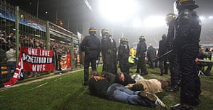 Police guard detained fans in Lens