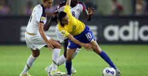 Marta of Brazil is tackled by US players during their 2007 women's World Cup