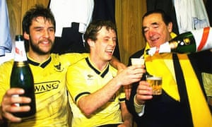 Jeremy Charles and Les Phillips of Oxford United celebrate with Robert Maxwell after their victory in the 1986 Milk Cup semi-final