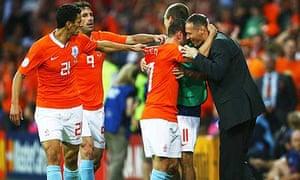 Wesley Sneijder celebrates with Marco van Basten