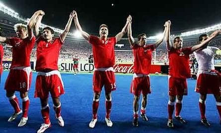 Austria players celebrate their draw with Poland