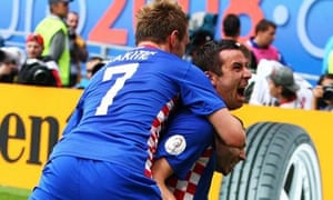 Darijo Srna of Croatia is congratulated by team mates after scoring his teams first goal during the UEFA EURO 2008 Group B match between Croatia and Germany at Worthersee Stadion on June 12, 2008 in Klagenfurt, Austria. (Photo by Martin Rose/Bongarts/Getty Images)