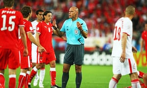 Howard Webb waves away protests after awarding a contentious penalty.