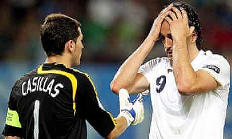 Italian striker Luca Toni is approached by goalkeeper Iker Casillas