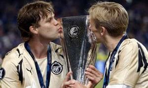Zenit St Peterburg's Vladislav Radimov, left, and Alexander Anyukov celebrate with the Uefa Cup