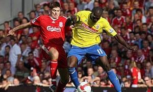 Liverpool's Steven Gerrard, left, and Stoke's Mamady Sidibe