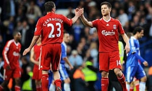 Liverpool's Jamie Carragher and Xabi Alonso shake hands after the final whistle at Stamford Bridge