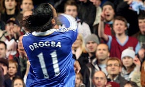 Didier Drogba throws an object back at Burnley fans