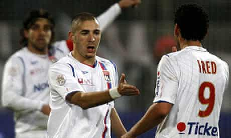 Lyon striker Karim Benzema celebrates with Fred and Juninho, left, against Bordeaux