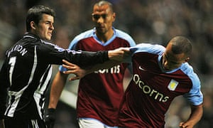 Newcastle midfielder Joey Barton tussles with Gabriel Agbonlahor