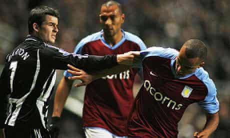 Newcastle midfielder Joey Barton tussles with Gabriel Agbonlahor