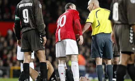 Wayne Rooney has words with referee Duhamel Laurent.