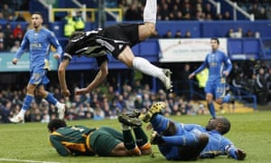 Newcastle's Michael Owen scores against Portsmouth at Fratton Park
