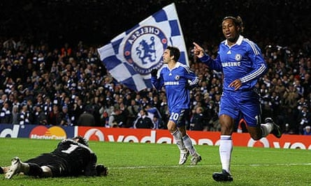 Didier Drogba celebrates scoring the second goal for Chelsea against Cluj