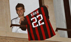 AC Milan's Kaka shows his jersey from the window of his house in Milan