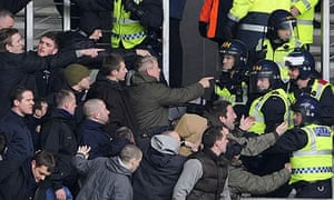 Riot police control Milwall fans during the FA Cup game at Hull