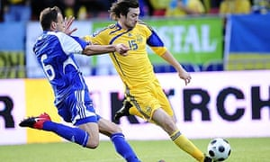 Ukraine's Artem Milevkiy, right, duels for the ball with Andorra's Ildefons Lima