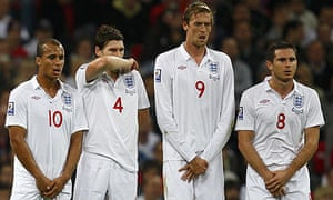 England's players brace themselves for a free kick by Belarus
