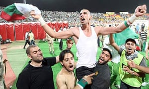 Algeria's Faouzi Chaouchi celebrates after his team's 1-0 win over Egypt in their World Cup play-off