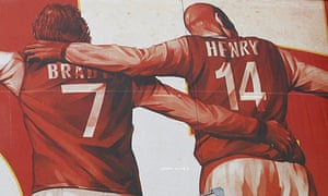 Thierry Henry and Liam Brady get up close and personal on this Emirates Stadium mural.