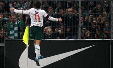 Mesut Özil celebrates his team's fourth goal at Freiburg
