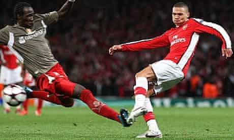 Standard Liege's Eliaquim Mangala tackles Arsenal's Kieran Gibbs