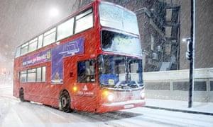 A London bus struggles through the snow