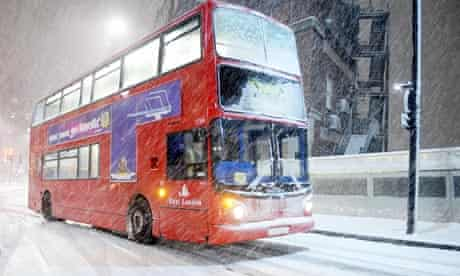A London bus struggles through the snow