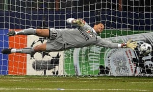 Inter goalkeeper Julio Cesar dives for the ball as Cristiano Ronaldo's free-kick flies just wide